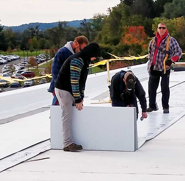 commercial roofing contractors hard at work